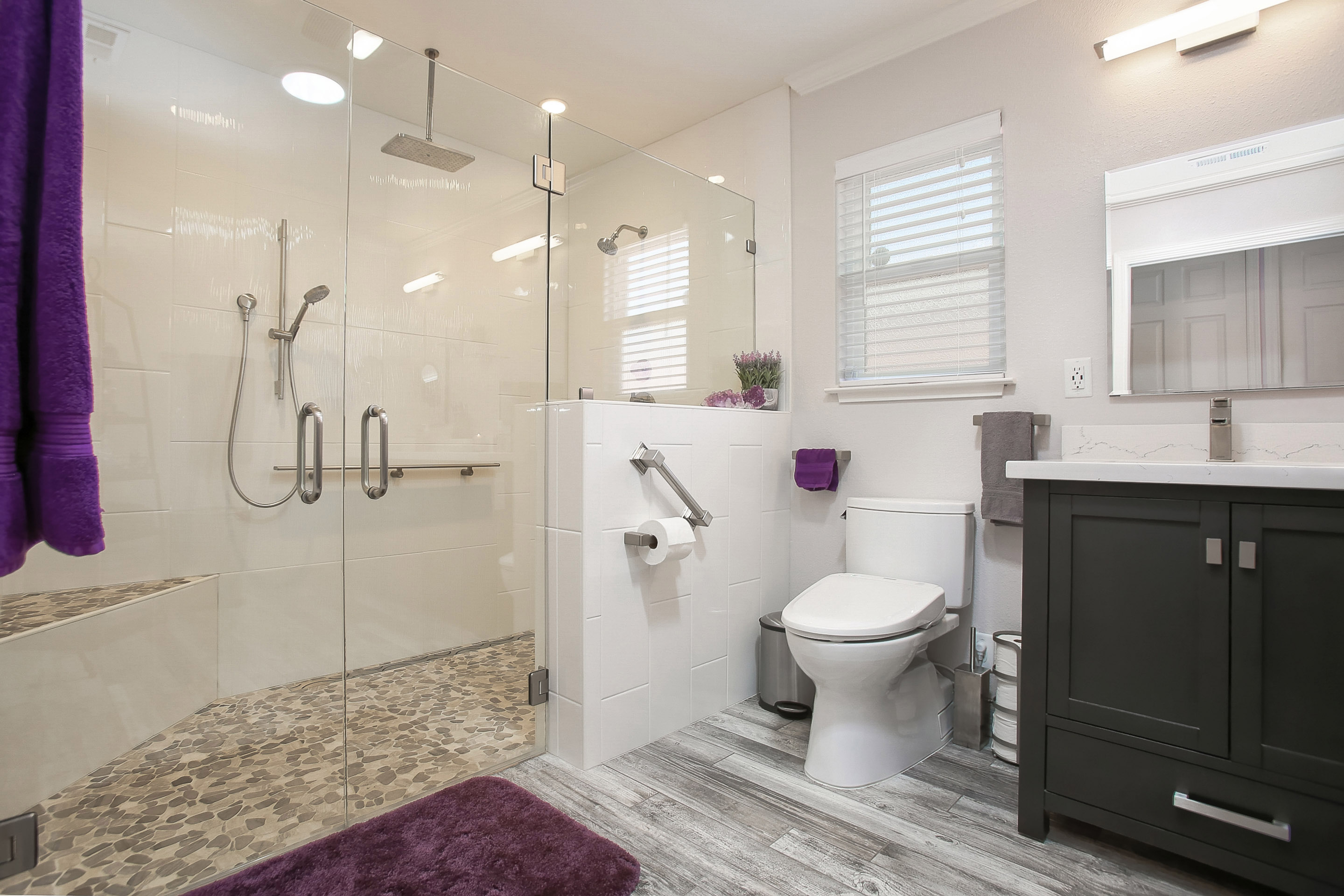 Sizeable walk-in shower with dual show heads.