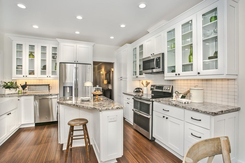 A quaint kitchen in a 111 year old historic remodel combines the best of days gone by and modern conveniences and technology.
