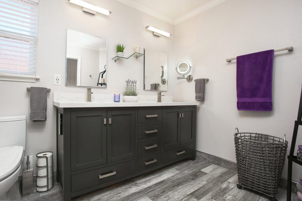 A previously crammed half bath transformed into a spacious place for pampering.