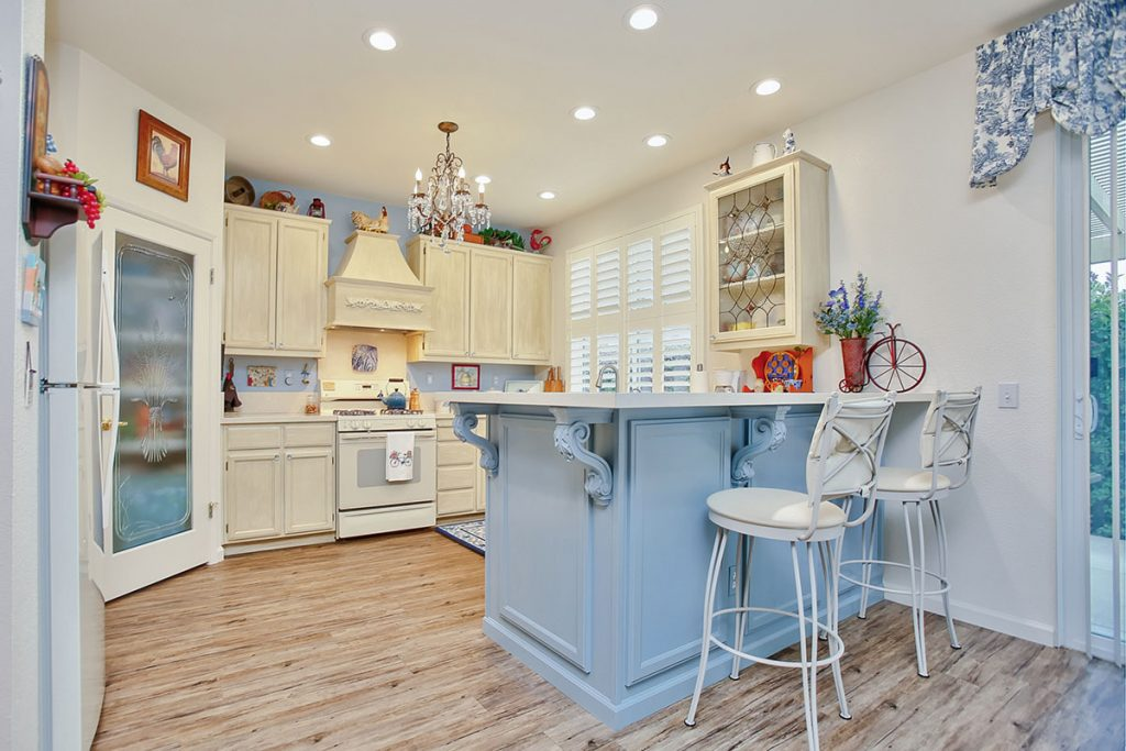 Decorative corbels and a pop of color made this breakfast bar so much more interesting!