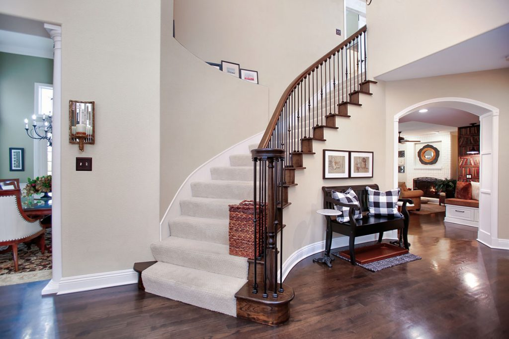 Dark stained wood decorative staircase.