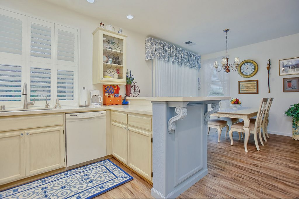 An ornamental glass cabinet door gives this kitchen extra contrast and character.