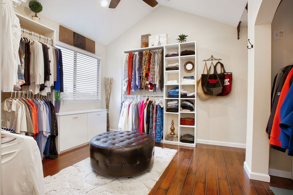Spacious and organized walk-in closet.