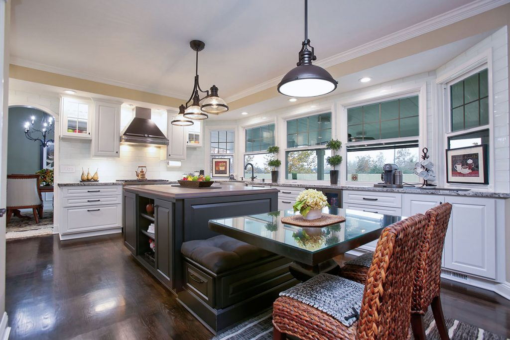 Stylish and functional kitchen banquette attatched to a spacious kitchen island. Beautiful and brilliant.