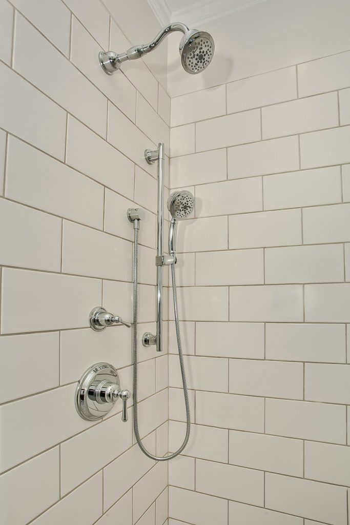This detachable hand shower moves up and down a slide bar for ease of use and to accommodate an individual user's height and preference.