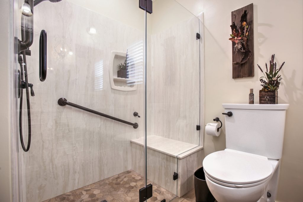 A restrictive tub transformed into a beautiful walk-in shower.