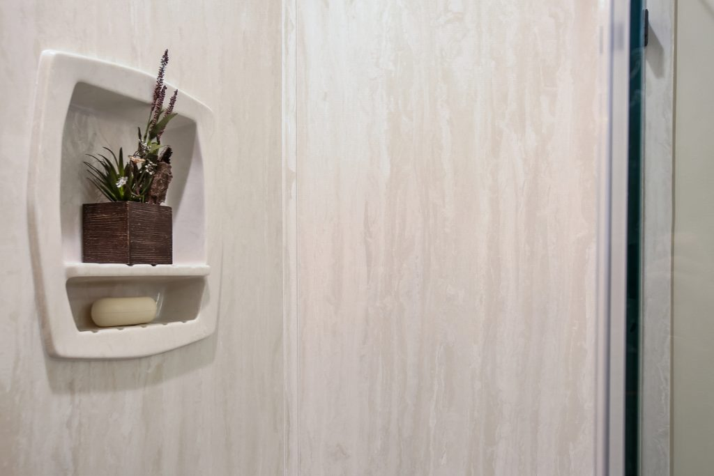 Cultured marble shower walls.