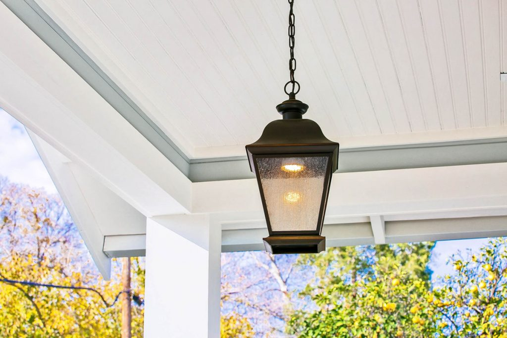 This beautiful vintage chandelier adds both style and security to this homeowner's front porch.