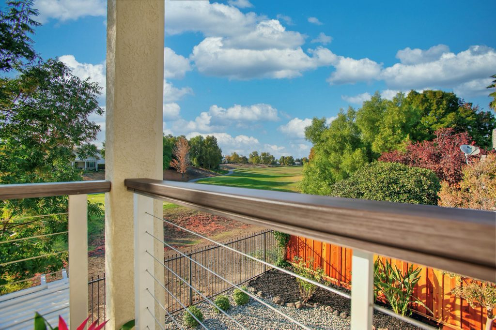 A cable rail is the jewel in the crown of this new balcony off the master suite that overlooks the golf course.