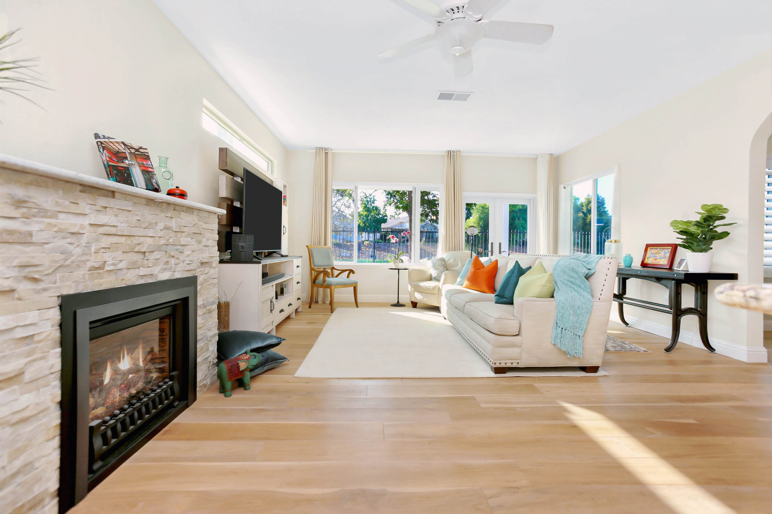 These homeowners are as snug as a couple of bugs in a rug with their newly expanded family room.