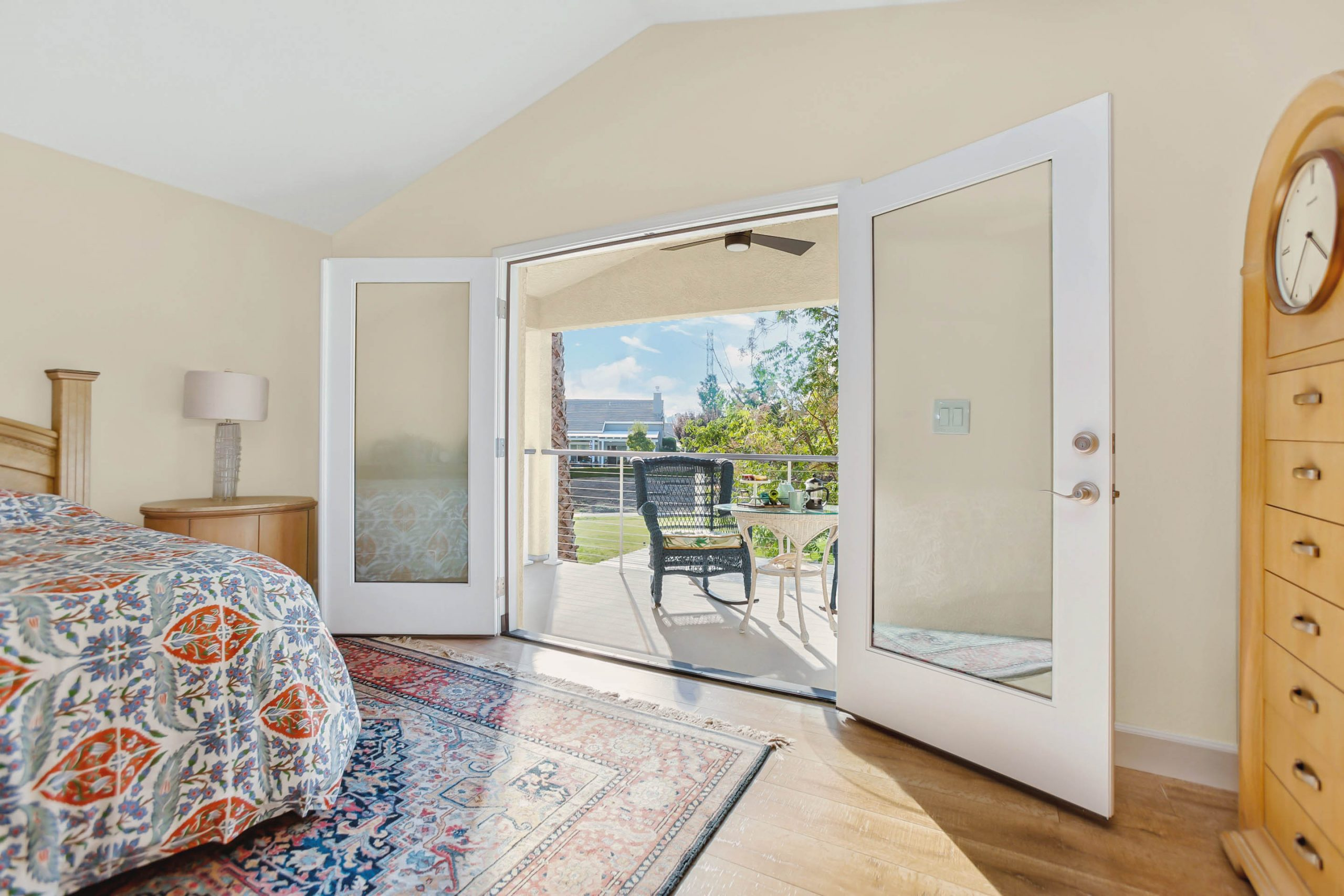 Voilà! A window gets removed and a pair of French doors installed with access to a spacious balcony overlooking the golf course.