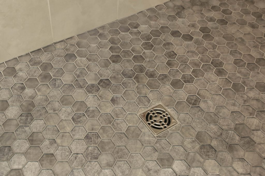 Hexagonal glass tile shower floor